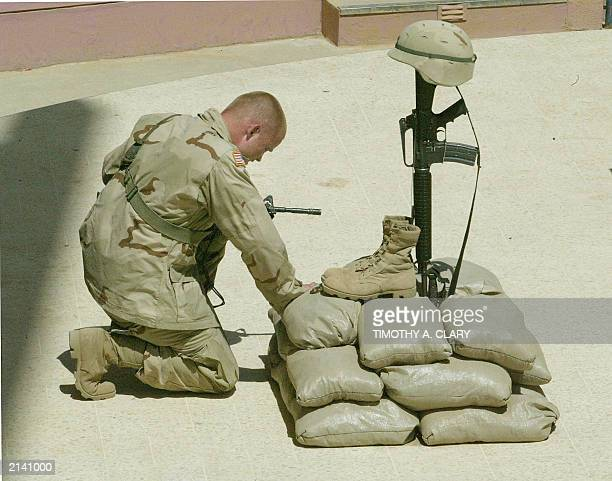 Sgt Dennis Duell of the 137th Armoured Battalion touches the belongings of the late Private First Class Shawn Pahnke after a memorial service 20 June...