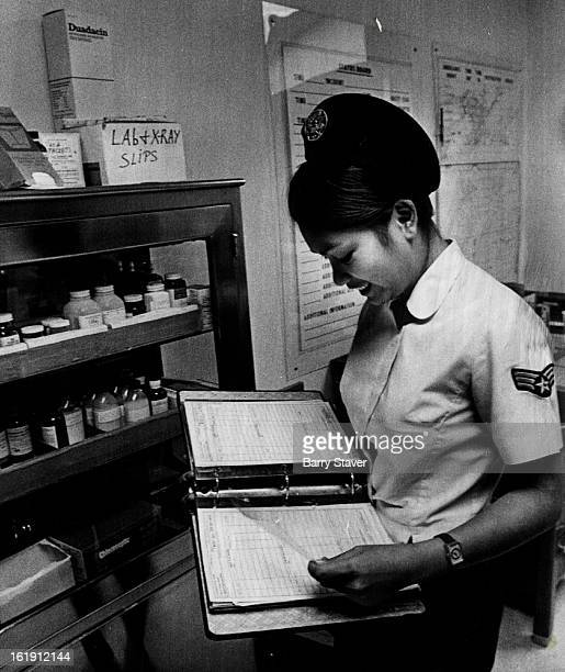 1972 JAN 17 1973 JAN 21 1973 Sgt Dolotina who works in medical administrative capacity checks charts and records in Lowry Air Force Base Dispensary