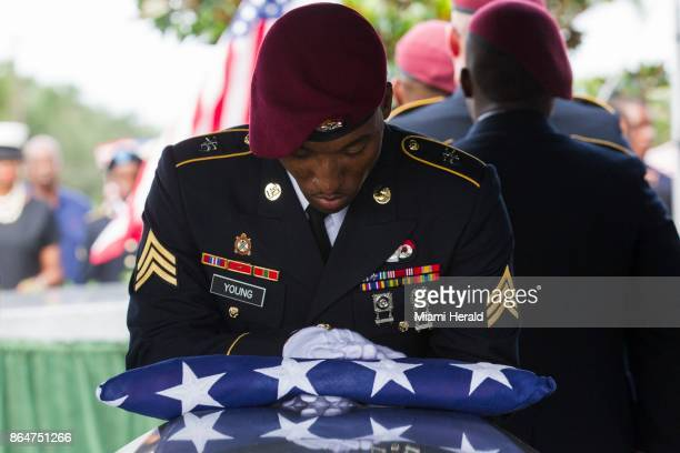 Sgt Donald Young places a US flag over the casket of Sgt La David Johnson during his burial service at Fred Hunter's Hollywood Memorial Gardens in...