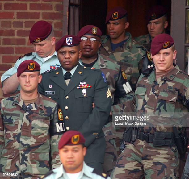 Sgt Hasan Akbar is led from the Staff Judge Advocate Building after the first day of sentencing procedures April 25 2005 in Fort Bragg North Carolina...