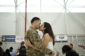 Sgt Johnathan Link of the US Army's Battery B 2nd Battalion 44th Air Defense Artillery Regiment 101st Airborne Division kissess his girlfriend...