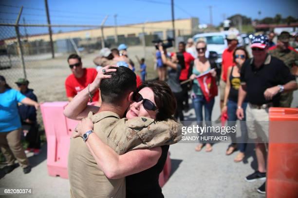 Sgt Nicholas Vickers hugs his Mom Teresa during a homecoming reception at Camp Pendleton in Oceanside California on May 11 2017 Marines and sailors...