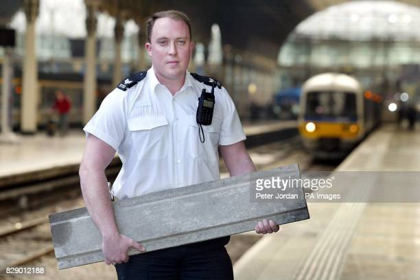 Sgt Richard Mitchell from the British Transport Police with a slab of concrete that was found on the tracks near Paddington Station The obstacles...