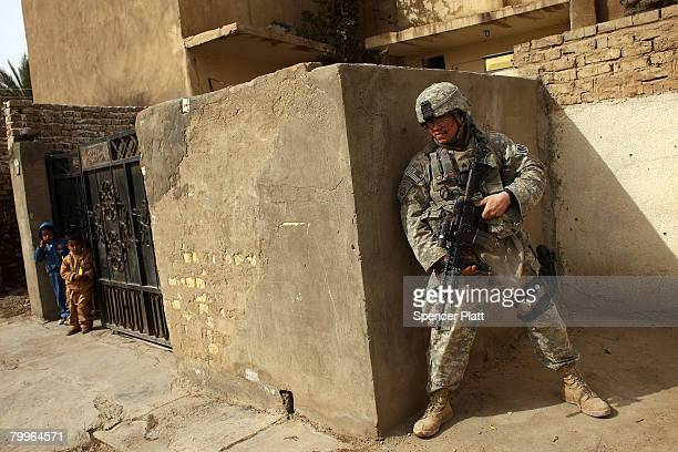 Sgt Ricky Butler with the US Army 501st MP Company 1st Armored Division and of Memphis Tennessee participates in a joint patrol with members of the...