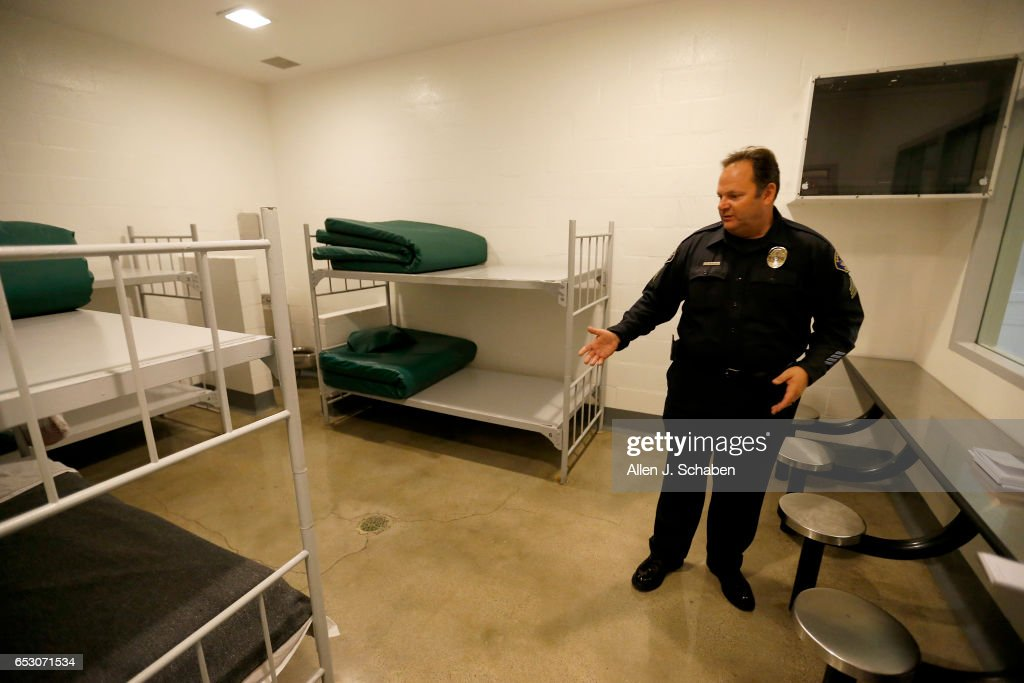 Sgt. Steven Bowles gives a tour of a jail dorm where pay-to-stay program inmates can watch television at the Seal Beach Detention center in Seal Beach. Project is a first-ever review of all 26 pay to stay jails in Southern California, where we've found inmates convicted of violent crimes and sex crimes, and repeat offenders. Seal Beach is by far the most lucrative of the programs, and appears to allow the most serious charges. Photo taken Tuesday, Nov. 29, 2016.
