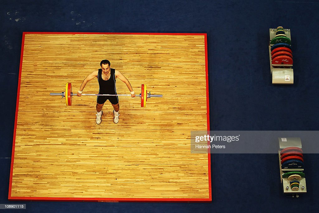Sh S Hussain Alahmad of Athletes from Kuwait competes in the Men's Weightlifting 77kg competition during day four of the 16th Asian Games Guangzhou 2010 at Dongguan Gymnasium on November 16, 2010 in Guangzhou, China.