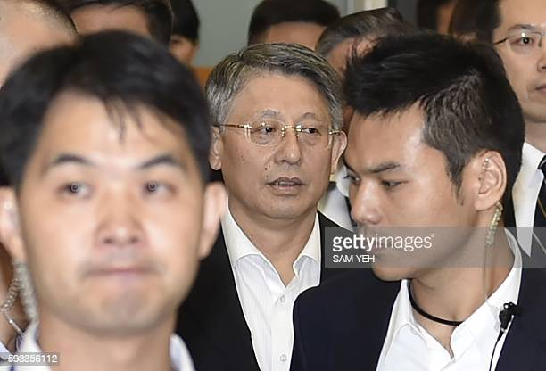 Sha Hailin Shanghai Municipal Committee United Front Work Department Director is surrounded by security staffs as he arrives at Songshan airport in...