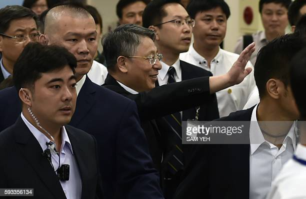 Sha Hailin Shanghai Municipal Committee United Front Work Department Director waves as he arrives at Songshan airport in Taipei on August 22 2016...