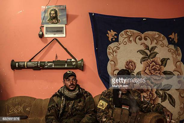 Shabak fighters Fouad 27 years old and Ahmed 25 years old of the Hashid AlShaabi's Babylon Brigade rest after a patrol at their base on January 28...