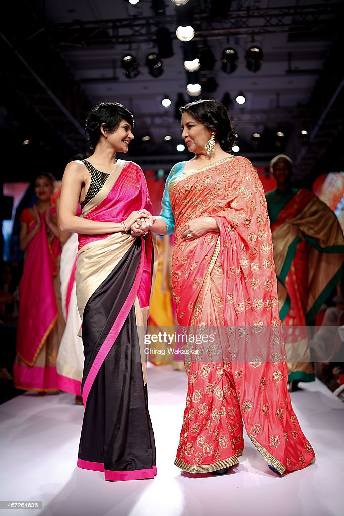 <a gi-track='captionPersonalityLinkClicked' href=/galleries/search?phrase=Shabana+Azmi&family=editorial&specificpeople=565786 ng-click='$event.stopPropagation()'>Shabana Azmi</a> (R) walks the runway with <a gi-track='captionPersonalityLinkClicked' href=/galleries/search?phrase=Mandira+Bedi&family=editorial&specificpeople=703799 ng-click='$event.stopPropagation()'>Mandira Bedi</a> (L) on day 5 of Lakme Fashion Week Summer/Resort 2015 at Palladium Hotel on March 22, 2015 in Mumbai, India.