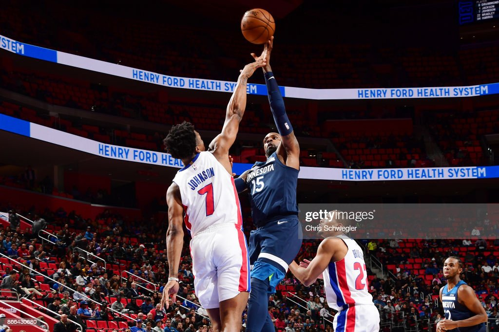 Shabazz Muhammad #15 of the Minnesota Timberwolves and Stanley Johnson #7 of the Detroit Pistons vie for the ball during the game on October 25, 2017 at Little Caesars Arena in Detroit, Michigan.