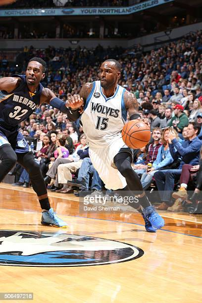 Shabazz Muhammad of the Minnesota Timberwolves drives against Jeff Green of the Memphis Grizzlies on January 23 2016 at Target Center in Minneapolis...