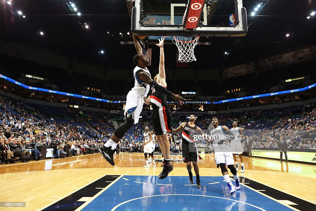Shabazz Muhammad #15 of the Minnesota Timberwolves dunks against the Portland Trail Blazers on December 10, 2014 at Target Center in Minneapolis, Minnesota.