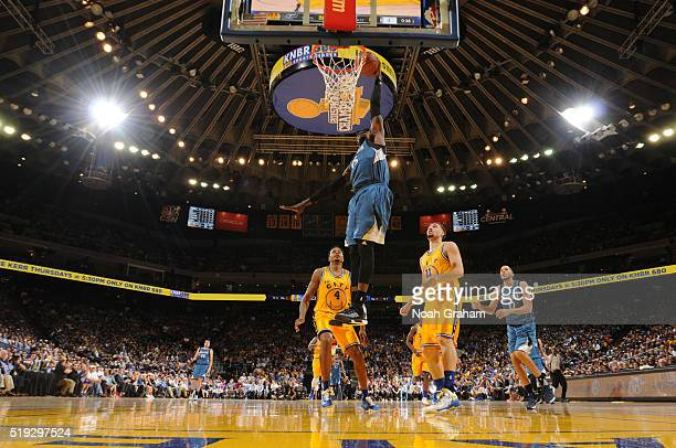Shabazz Muhammad of the Minnesota Timberwolves dunks against the Golden State Warriors on April 5 2016 at Oracle Arena in Oakland California NOTE TO...