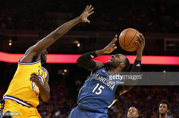 Shabazz Muhammad of the Minnesota Timberwolves goes up for a shot against Draymond Green of the Golden State Warriors at ORACLE Arena on April 5 2016...