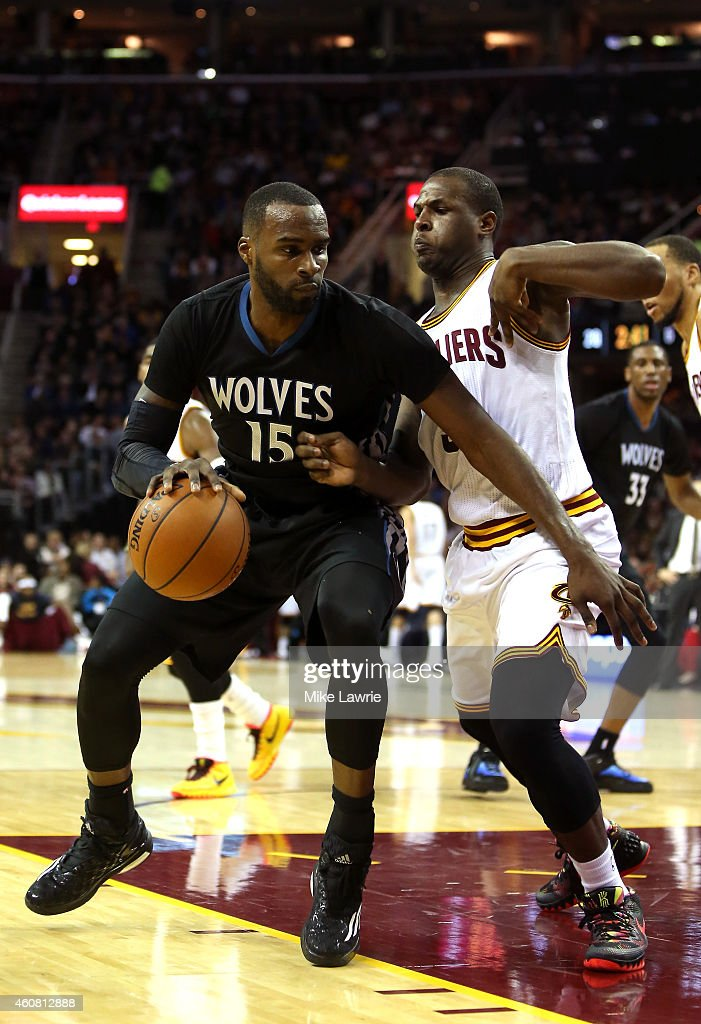 <a gi-track='captionPersonalityLinkClicked' href=/galleries/search?phrase=Shabazz+Muhammad&family=editorial&specificpeople=7447677 ng-click='$event.stopPropagation()'>Shabazz Muhammad</a> #15 of the Minnesota Timberwolves handles the ball against <a gi-track='captionPersonalityLinkClicked' href=/galleries/search?phrase=Dion+Waiters&family=editorial&specificpeople=6902921 ng-click='$event.stopPropagation()'>Dion Waiters</a> #3 of the Cleveland Cavaliers in the first half at Quicken Loans Arena on December 23, 2014 in Cleveland, Ohio.