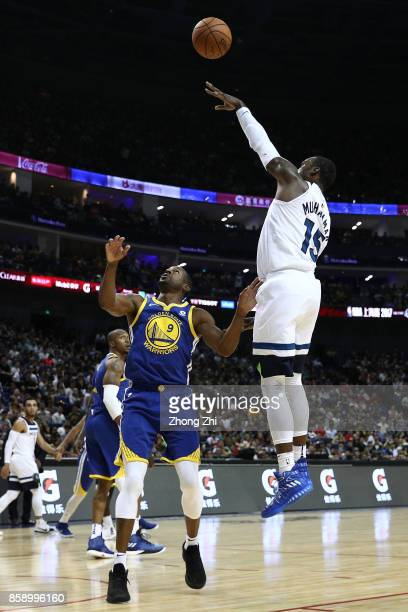 Shabazz Muhammad of the Minnesota Timberwolves in action against Andre Iguodala of the Golden State Warriors during the game between the Minnesota...