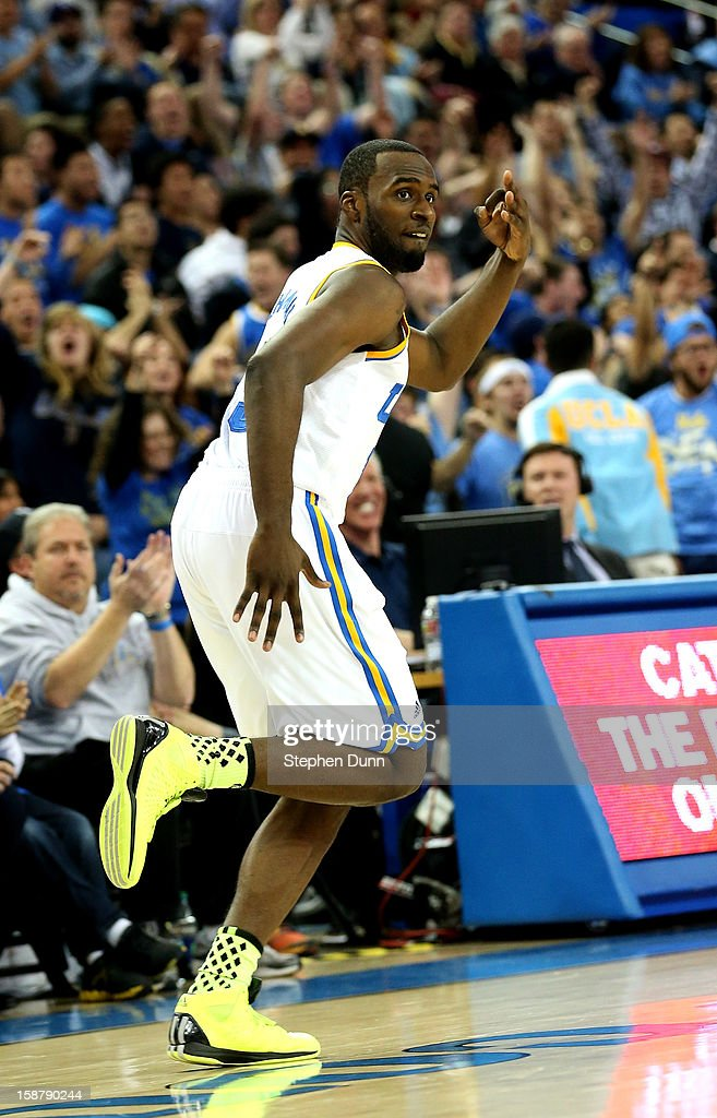 Shabazz Muhammad #15 of the UCLA Bruins celebrates after making a three point basket in overtime against the Missouri Tigers at Pauley Pavilion on December 28, 2012 in Los Angeles, California. UCLA won 97-94 in overtime.