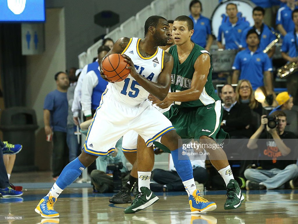 Shabazz Muhammad #15 of the UCLA Bruins controls the ball against Chris Eversley #33 of the Cal Poly Mustangs at Pauley Pavilion on November 25, 2012 in Los Angeles, California.