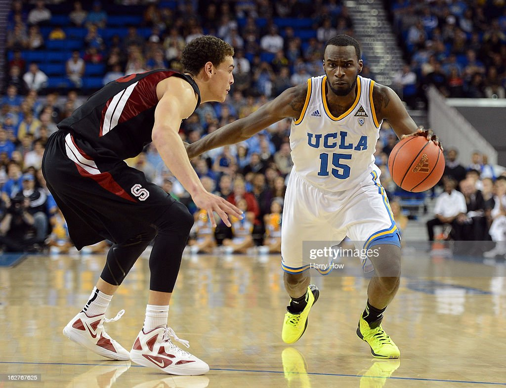 Shabazz Muhammad #15 of the UCLA Bruins drives on Dwight Powell #33 of the Stanford Cardinal at Pauley Pavilion on January 5, 2013 in Los Angeles, California.