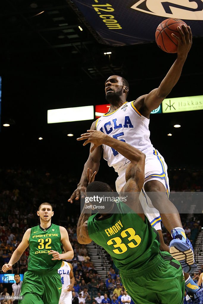 Shabazz Muhammad #15 of the UCLA Bruins goes up against the defense of Carlos Emory #33 of the Oregon Ducks in the first half of the Pac-12 Championship game at MGM Grand Garden Arena on March 16, 2013 in Las Vegas, Nevada.