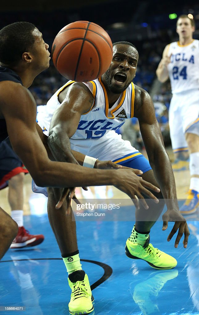 <a gi-track='captionPersonalityLinkClicked' href=/galleries/search?phrase=Shabazz+Muhammad&family=editorial&specificpeople=7447677 ng-click='$event.stopPropagation()'>Shabazz Muhammad</a> #15 of the UCLA Bruins goes up for a loose ball with Aaron Anderson #11 of the Fresno State Bulldogs at Pauley Pavilion on December 22, 2012 in Los Angeles, California. UCLA won 91-78.