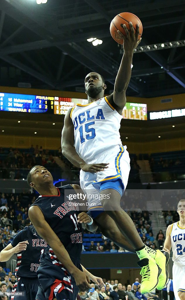 Shabazz Muhammad #15 of the UCLA Bruins goes up for a shot over Aaron Anderson #11 of the Fresno State Bulldogs at Pauley Pavilion on December 22, 2012 in Los Angeles, California. UCLA won 91-78.