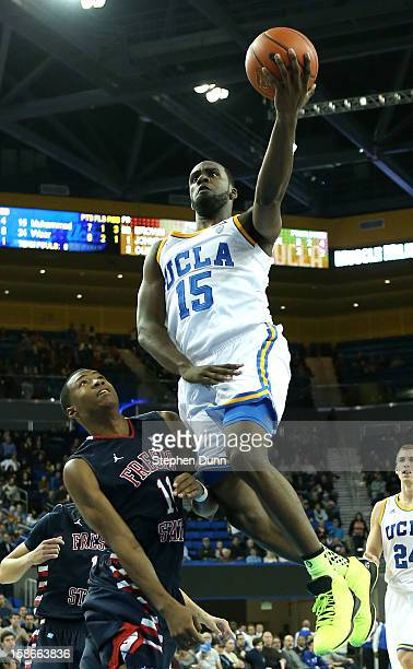Shabazz Muhammad of the UCLA Bruins goes up for a shot over Aaron Anderson of the Fresno State Bulldogs at Pauley Pavilion on December 22 2012 in Los...