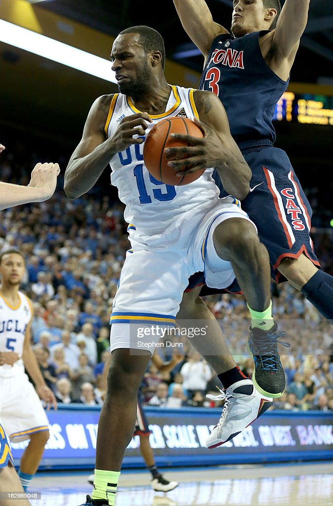 <a gi-track='captionPersonalityLinkClicked' href=/galleries/search?phrase=Shabazz+Muhammad&family=editorial&specificpeople=7447677 ng-click='$event.stopPropagation()'>Shabazz Muhammad</a> #15 of the UCLA Bruins grabs a rebound to put the game away against the Arizona Wildcats at Pauley Pavilion on March 2, 2013 in Los Angeles, California. UCLA won 74-69.