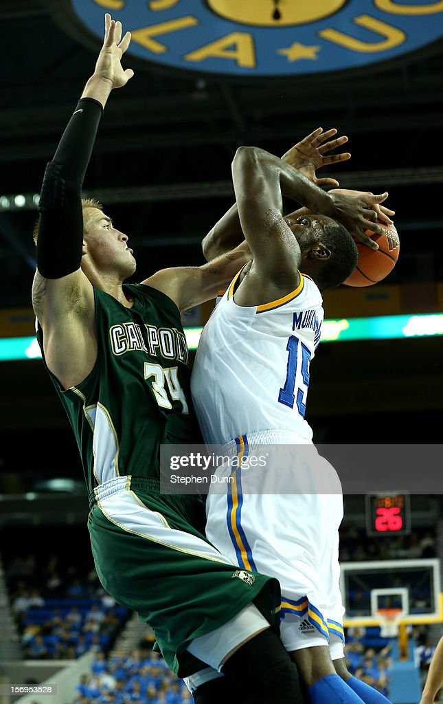 Shabazz Muhammad #15 of the UCLA Bruins picks up a foul against Brian Bennett #34 of the Cal Poly Mustangs at Pauley Pavilion on November 25, 2012 in Los Angeles, California. Cal Poly won 70-68.