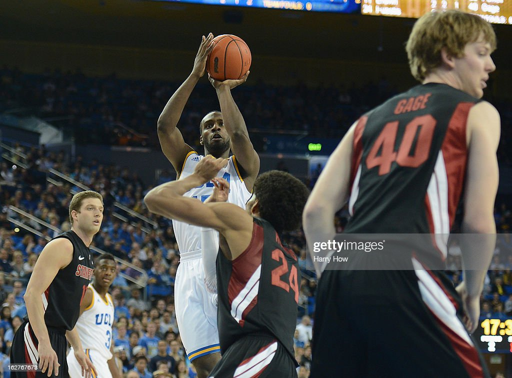 Shabazz Muhammad #15 of the UCLA Bruins shoots a jumper over Josh Huestis #24 of the Stanford Cardinal at Pauley Pavilion on January 5, 2013 in Los Angeles, California.