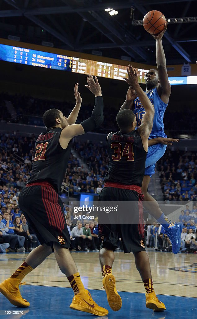 <a gi-track='captionPersonalityLinkClicked' href=/galleries/search?phrase=Shabazz+Muhammad&family=editorial&specificpeople=7447677 ng-click='$event.stopPropagation()'>Shabazz Muhammad</a> #15 of the UCLA Bruins shoots over Aaron Fuller #21 and Eric Wise #34 of the USC Trojans in the second half at Pauley Pavilion on January 30, 2013 in Los Angeles, California. USC defeated UCLA 75-71 in overtime.