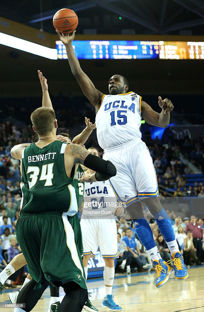 Shabazz Muhammad #15 of the UCLA Bruins shoots over Brian Bennett #34 of the Cal Poly Mustangs at Pauley Pavilion on November 25, 2012 in Los Angeles, California. Cal Poly won 70-68.