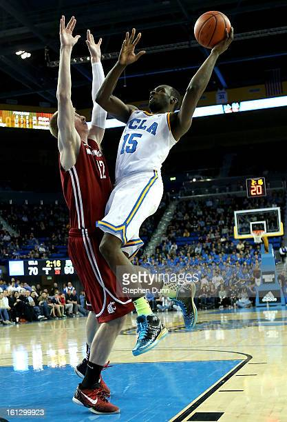 Shabazz Muhammad of the UCLA Bruins shoots over Brock Motum Washington State Cougars at Pauley Pavilion on February 9 2013 in Los Angeles California...