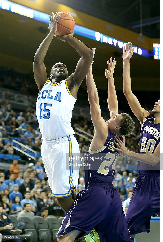 Shabazz Muhammad #15 of the UCLA Bruins shoots over Ryan Gesiakowski #24 and Jules Montgomery #20 of the Prairie View A&M Panthersat Pauley Pavilion on December 15, 2012 in Los Angeles, California. UCLA won 95-53.
