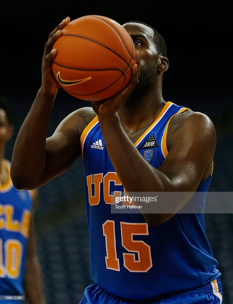 <a gi-track='captionPersonalityLinkClicked' href=/galleries/search?phrase=Shabazz+Muhammad&family=editorial&specificpeople=7447677 ng-click='$event.stopPropagation()'>Shabazz Muhammad</a> #15 of the UCLA Bruins takes free throw against the Texas Longhorns during the MD Anderson Proton Therapy Showcase at Reliant Stadium on December 8, 2012 in Houston, Texas.