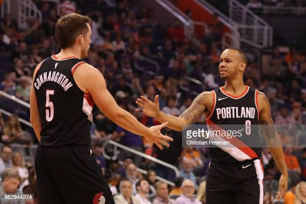 Shabazz Napier of the Portland Trail Blazers high fives Pat Connaughton after scoring against the Phoenix Suns during the second half of the NBA game...