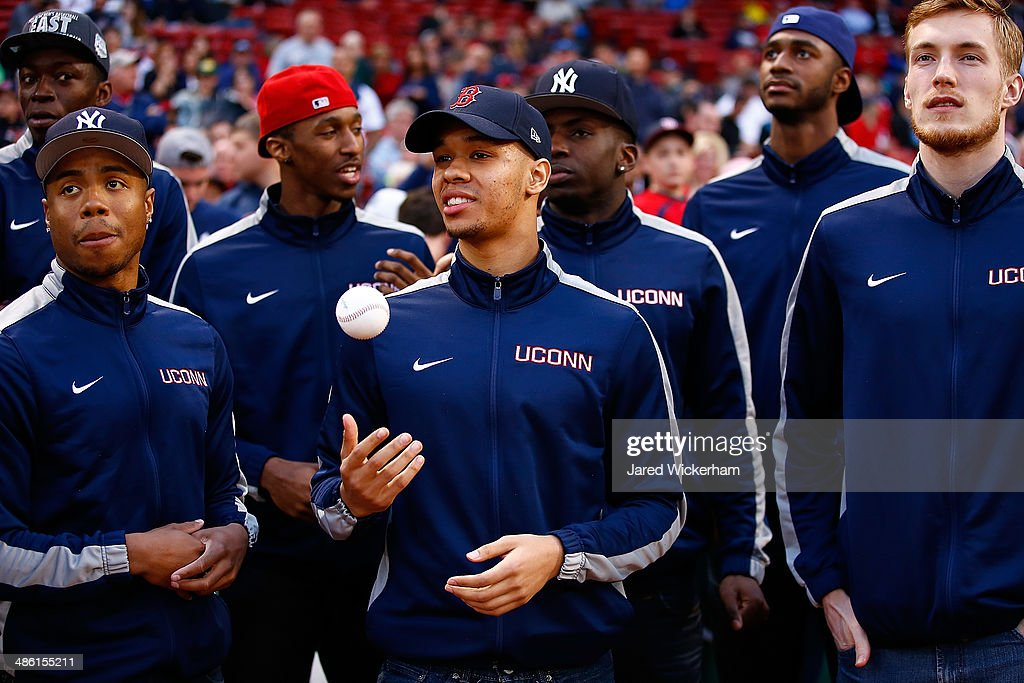 Shabazz Napier #13 and members of the national champion Connecticut Huskies basketball team wait to throw out the first pitch prior to the game between the Boston Red Sox and the New York Yankees at Fenway Park on April 22, 2014 in Boston, Massachusetts.