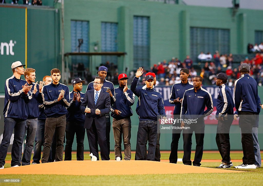 Shabazz Napier #13 and members of the national champion Connecticut Huskies basketball team wait to throw out the first pitch alongside Connecticut governor Dannel Malloy prior to the game between the Boston Red Sox and the New York Yankees at Fenway Park on April 22, 2014 in Boston, Massachusetts.