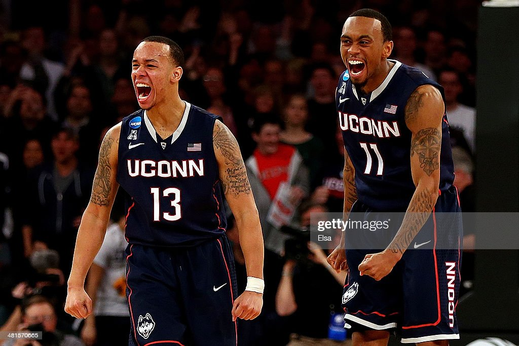 <a gi-track='captionPersonalityLinkClicked' href=/galleries/search?phrase=Shabazz+Napier&family=editorial&specificpeople=7338263 ng-click='$event.stopPropagation()'>Shabazz Napier</a> #13 and Ryan Boatright #11 of the Connecticut Huskies reacts after a play late in the game against the Michigan State Spartans during the East Regional Final of the 2014 NCAA Men's Basketball Tournament at Madison Square Garden on March 30, 2014 in New York City.