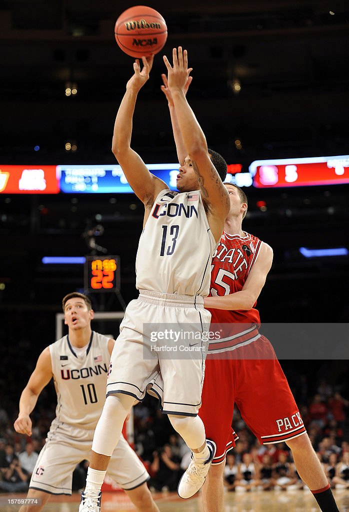 Shabazz Napier of Connecticut iss fouled while taking a shot by Scott Wood of North Carolina State in the first half of the Jimmy V Classic on Tuesday, December 4, 2012, at Madison Square Garden in New York.