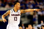 Shabazz Napier of the Connecticut Huskies calls a play against the Kentucky Wildcats during the NCAA Men's Final Four Championship at ATT Stadium on...