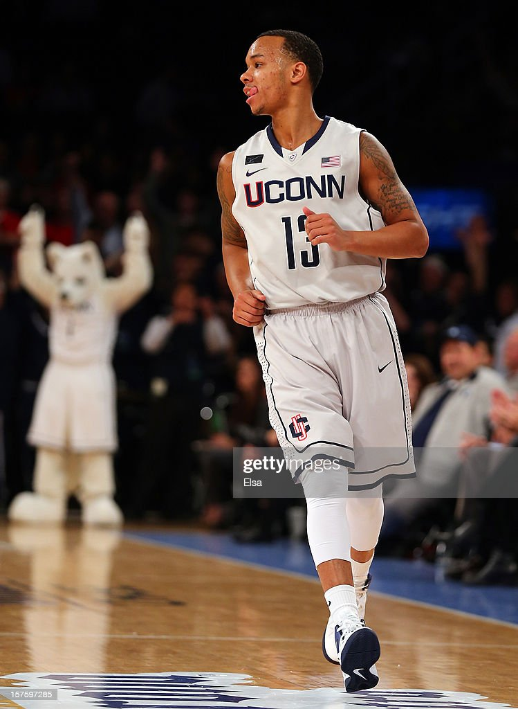 Shabazz Napier #13 of the Connecticut Huskies celebrates his three point shot in the first half against the North Carolina State Wolfpack during the Jimmy V Classic on December 4, 2012 at Madison Square Garden in New York City.
