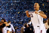 Shabazz Napier of the Connecticut Huskies celebrates on the court after defeating the Kentucky Wildcats 6054 in the NCAA Men's Final Four...