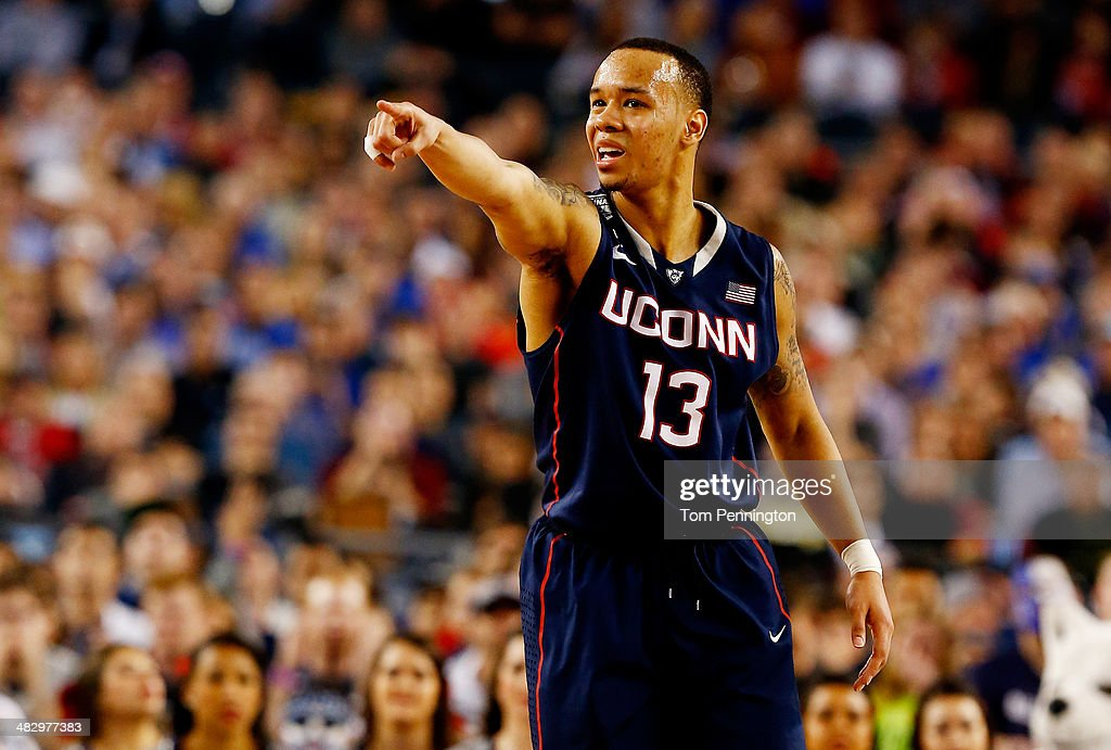 <a gi-track='captionPersonalityLinkClicked' href=/galleries/search?phrase=Shabazz+Napier&family=editorial&specificpeople=7338263 ng-click='$event.stopPropagation()'>Shabazz Napier</a> #13 of the Connecticut Huskies gestures during the NCAA Men's Final Four Semifinal against the Florida Gators at AT&T Stadium on April 5, 2014 in Arlington, Texas.