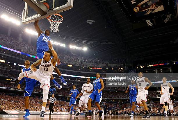 Shabazz Napier of the Connecticut Huskies goes to the basket as Alex Poythress of the Kentucky Wildcats defends during the NCAA Men's Final Four...