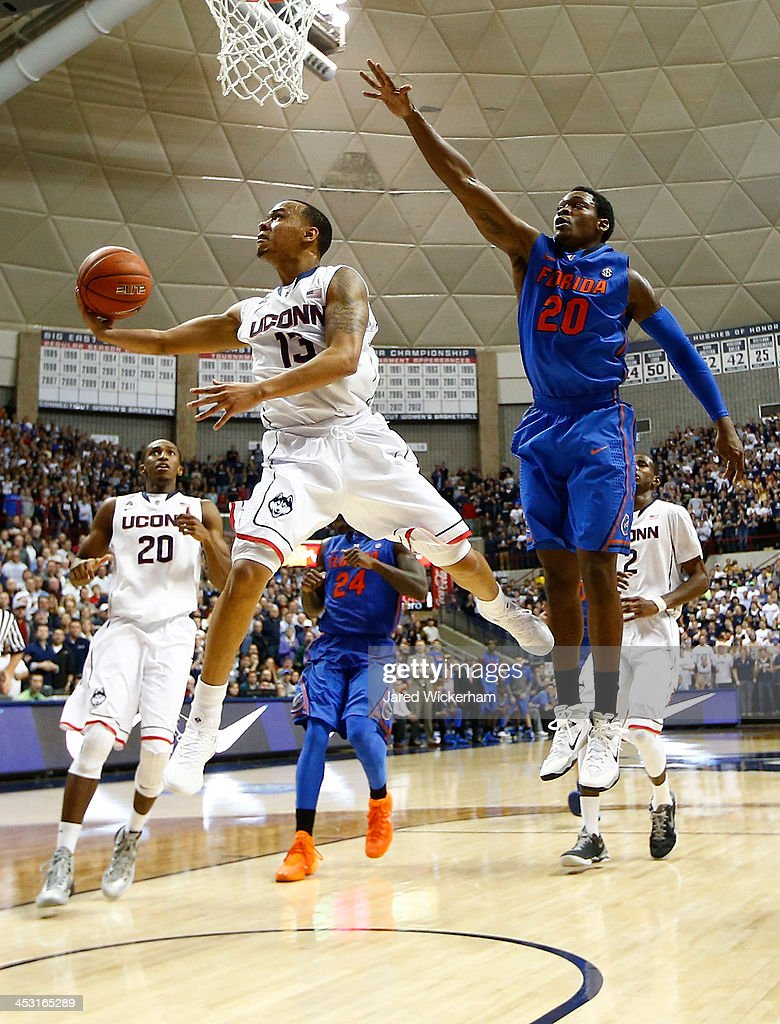 Shabazz Napier #13 of the Connecticut Huskies goes up for a layup against the Florida Gators in the second half during the game at Harry A. Gampel Pavilion on December 2, 2013 in Storrs, Connecticut.