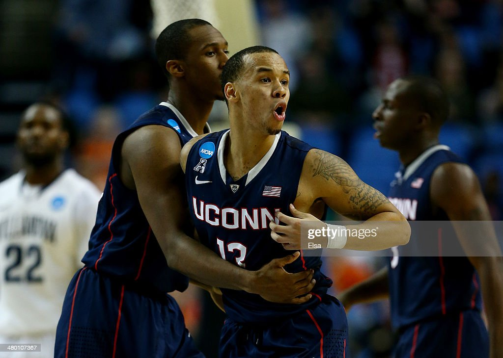 <a gi-track='captionPersonalityLinkClicked' href=/galleries/search?phrase=Shabazz+Napier&family=editorial&specificpeople=7338263 ng-click='$event.stopPropagation()'>Shabazz Napier</a> #13 of the Connecticut Huskies reacts against the Villanova Wildcats during the third round of the 2014 NCAA Men's Basketball Tournament at the First Niagara Center on March 22, 2014 in Buffalo, New York.