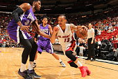 Shabazz Napier of the Miami Heat drives to the basket against Jason Thompson of the Sacramento Kings on March 7 2015 at American Airlines Arena in...