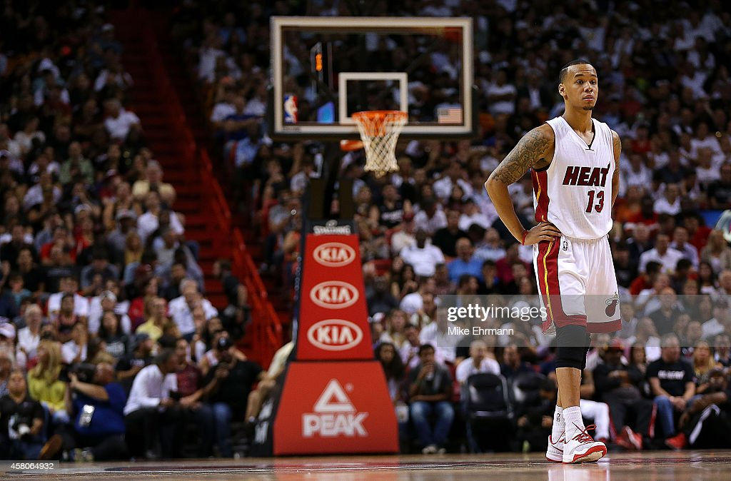 <a gi-track='captionPersonalityLinkClicked' href=/galleries/search?phrase=Shabazz+Napier&family=editorial&specificpeople=7338263 ng-click='$event.stopPropagation()'>Shabazz Napier</a> #13 of the Miami Heat looks on during the Opening night game against the Washington Wizards at American Airlines Arena on October 29, 2014 in Miami, Florida.